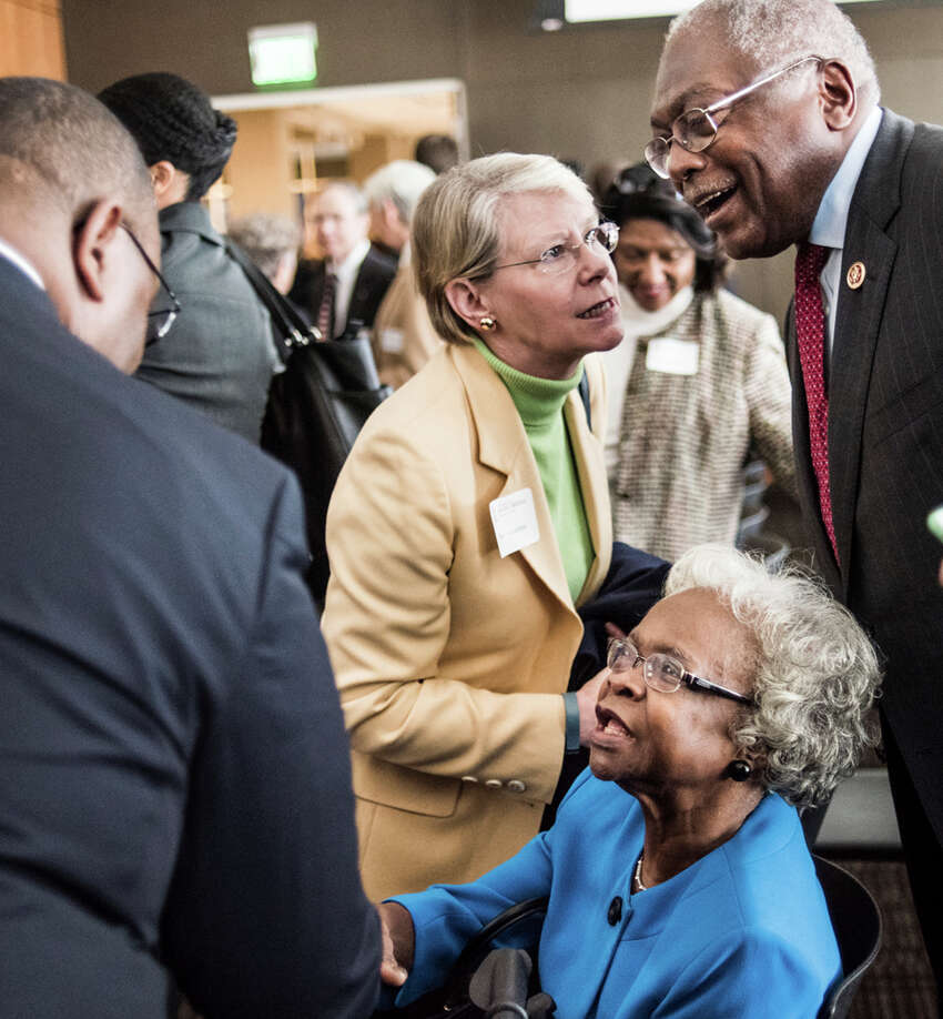 FILE - In this Nov. 23, 2015, file photo, Emily Clyburn, bottom, and her husband, U.S. Rep. James Clyburn, top right, talk to people at the University of South Carolina in Columbia, S.C. Emily Clyburn, the wife of House Majority Whip Jim Clyburn of South Carolina who helped raise millions of dollars to help students attend the alma mater they shared, died in Columbia on Thursday morning, Sept. 19, 2019. according to the congressmana€™s office. She was 80. (AP Photo/Sean Rayford, File)