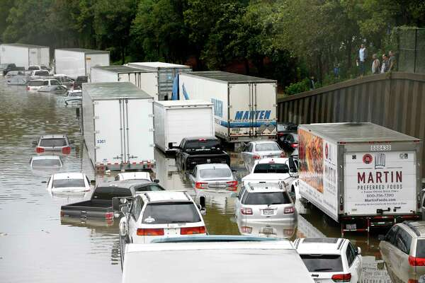 Abandoned cars and trucks in southbound I-45 near Main Street are flooded in water after Imelda made its way through the Heights area of Houston on Thursday, Sept. 19, 2019.