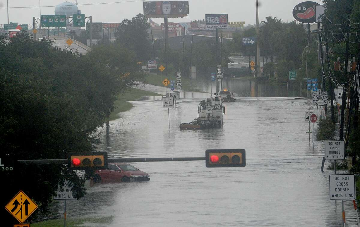 Flooded vehicles alomg I-10 west frontage road is pictured in Beaumont where several roads remained heavily flooded throughout the afternoon. Boaters and other emergency personnel were conducting rescue missions to those in need throughout the morning and afternoon. Photo taken Thursday, September 19, 2019 Kim Brent/The Enterprise