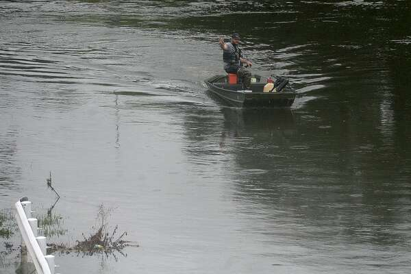 A rescue boater waves to others as he makes his way through floodwaters in Beaumont where several roads remained heavily flooded throughout the afternoon. Boaters and other emergency personnel were conducting rescue missions to those in need throughout the morning and afternoon. Photo taken Thursday, September 19, 2019 Kim Brent/The Enterprise