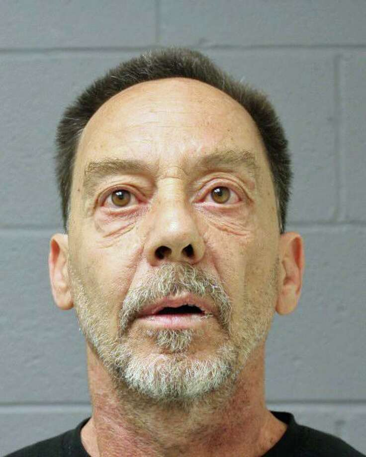 John Petrocelli, 56, of Meriden, was charged with driving under the influence, criminal possession of a firearm, violation of a protective order, weapons in a motor vehicle, possession of marijuana and possession of drug paraphernalia. Photo: Contributed Photo / Newtown Police Department