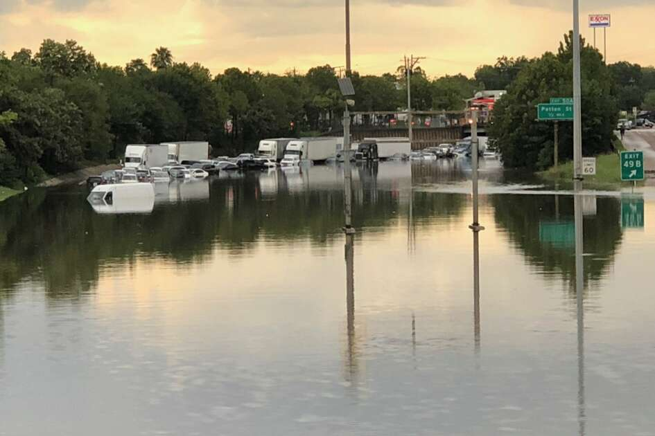 Dozens of cars sit stranded Thursday along a flooded portion of Interstate 45 in Woodland Heights, Sept. 19, 2019.