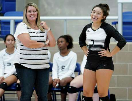 Steele senior libero Geneva Moreno laughs with coach Jordan Madill during a match last season. Moreno notched her 2,000th career dig Tuesday in a loss to top-ranked Clemens.