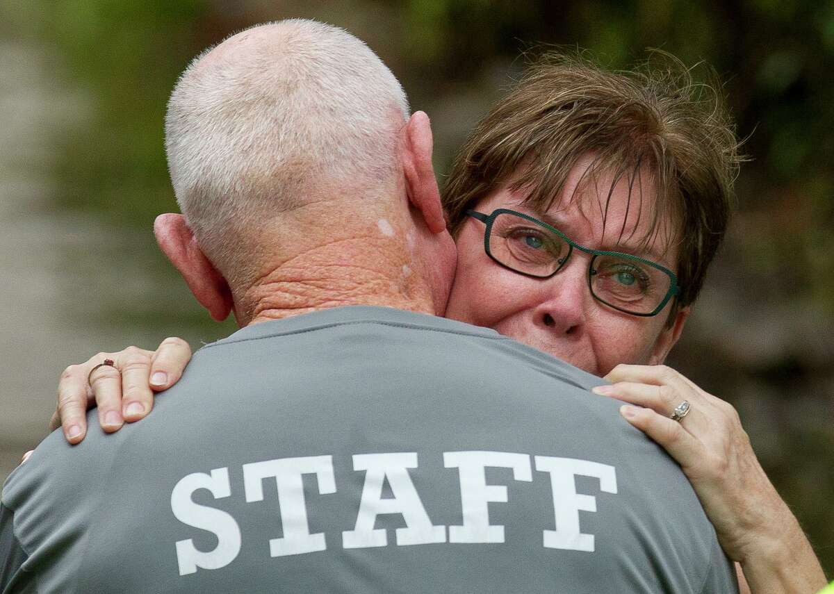 """Jane Frazier embraces her husband, Mike, as he returns to his home in the Elm Grove subdivision after more than seven hours after leaving work in downtown Houston, Thursday, Sept. 19, 2019, in Kingwood. """"We didn't expect it to happen again,"""" Jane Frazier said after the family's home flooded in May. """"I mean, what are we going to do?"""""""
