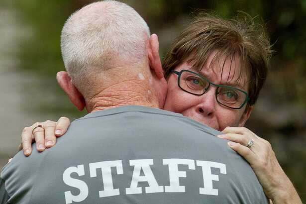 "Jane Frazier embraces her husband, Mike, as he returns to his home in the Elm Grove subdivision after more than seven hours after leaving work in downtown Houston, Thursday, Sept. 19, 2019, in Kingwood. ""We didn't expect it to happen again,"" Jane Frazier said after the family's home flooded in May. ""I mean, what are we going to do?"""