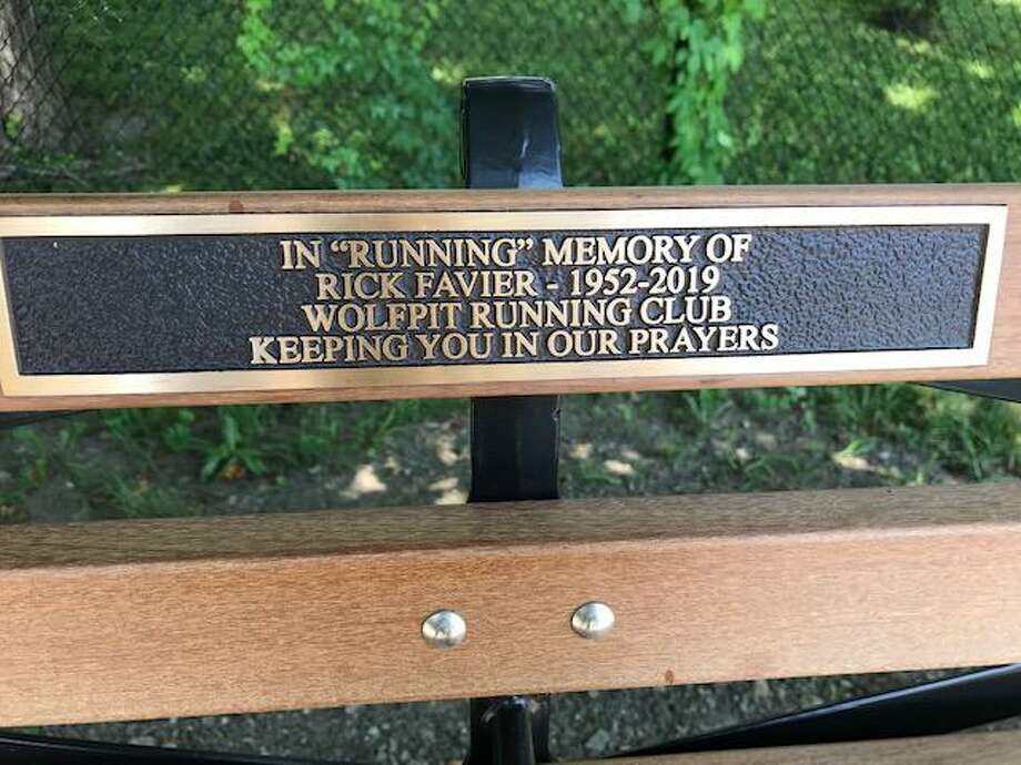 The inscription on the bench outside the Ridgefield Boys and Girls Club that honors Rick Favier. Photo: Contributed Photo