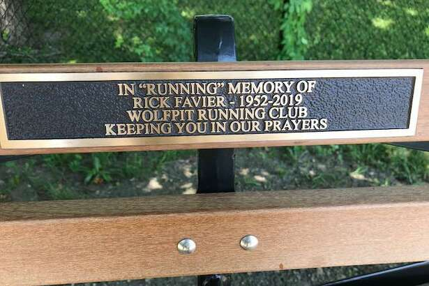 The inscription on the bench outside the Ridgefield Boys and Girls Club that honors Rick Favier.