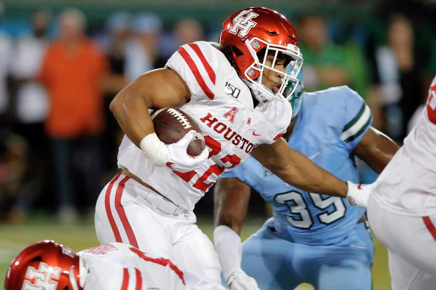 Houston running back Kyle Porter (22) carries during the first half of the team's NCAA college football game against Tulane in New Orleans, Thursday, Sept. 19, 2019. (AP Photo/Gerald Herbert)