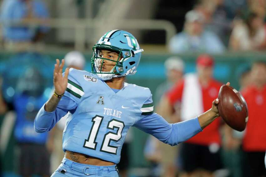 Tulane quarterback Justin McMillan throws a pass during the first half of the team's NCAA college football game against Houston in New Orleans, Thursday, Sept. 19, 2019. (AP Photo/Gerald Herbert)