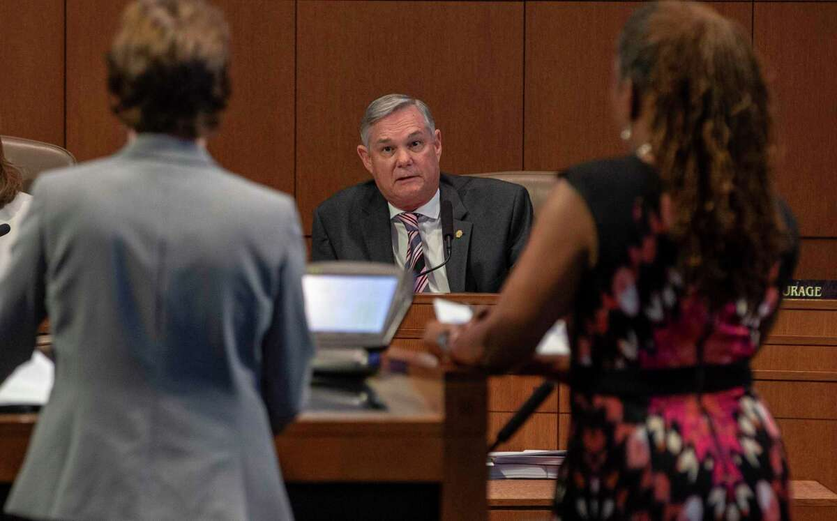 District 10 Councilman Clayton Perry, center, speaks at a City Council meeting in September. Perry plans to announce later this week that he will resign to run for Bexar County commissioner, sources said Monday.