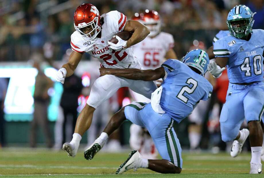 PHOTOS: UH vs. Tulane NEW ORLEANS, LOUISIANA - SEPTEMBER 19: Kyle Porter #22 of the Houston Cougars is tackled by P.J. Hall #2 of the Tulane Green Wave during the first half of a game at Yulman Stadium on September 19, 2019 in New Orleans, Louisiana. >>>See more photos from the Cougars' game against Tulane ... Photo: Jonathan Bachman, Getty Images / 2019 Getty Images