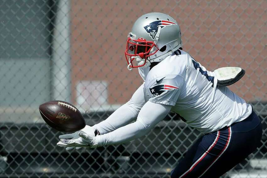 New England Patriots wide receiver Antonio Brown catches the ball during an NFL football practice, Wednesday, Sept. 18, 2019, in Foxborough, Mass. (AP Photo/Steven Senne)