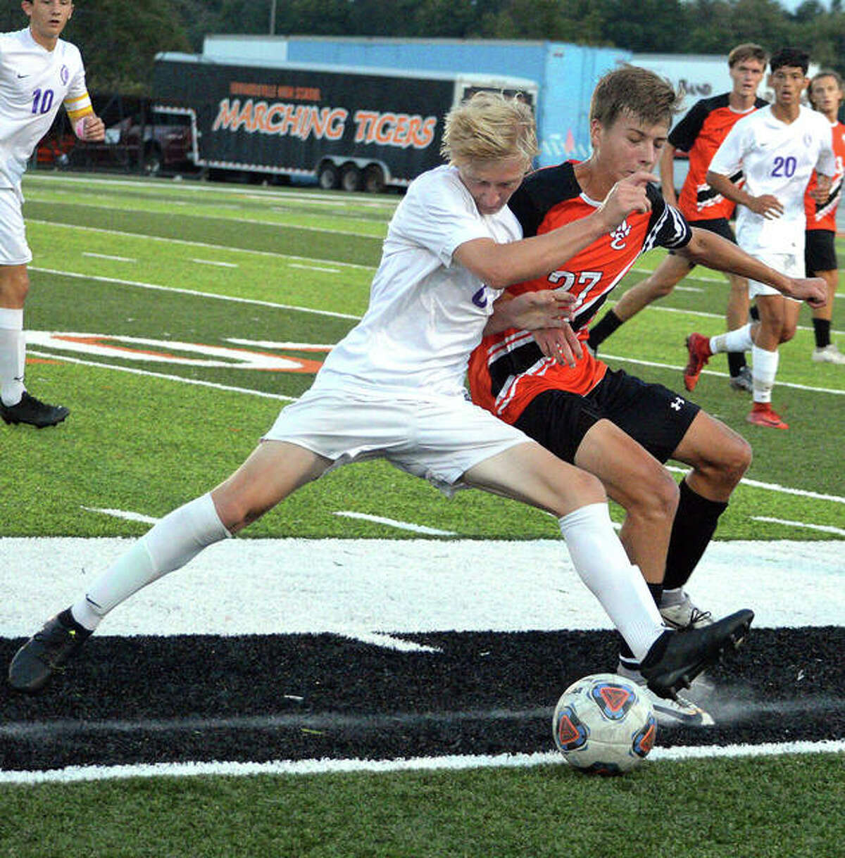 Edwardsville's Adam Sneed, right, and a Collinsville player chase down the ball during the first half of Thursday's game at the District 7 Sports Complex.