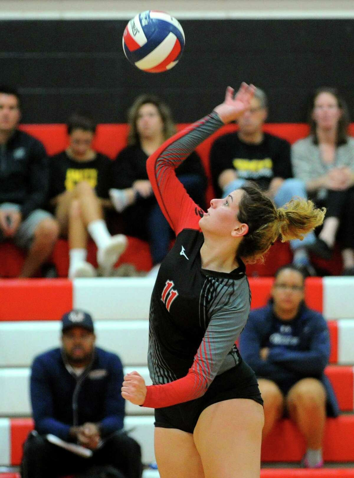 Cheshire's Julia Bartiet spikes the ball during girls volleyball action against Amity in Cheshire, Conn., on Thursday Sept. 19, 2019.