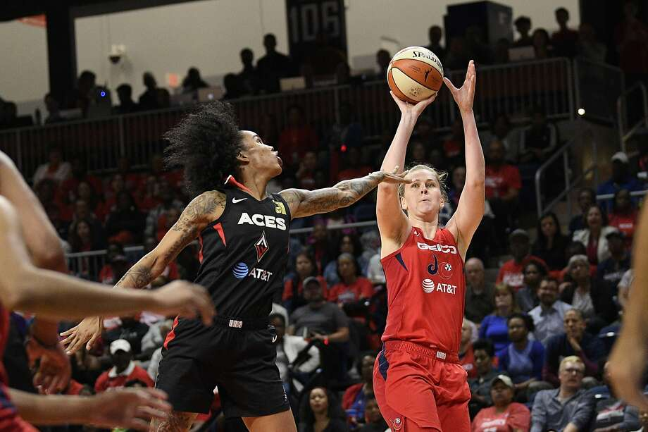Mystics center Emma Meesseman shoots over Aces forward Tamera Young on her way to 30 points. Photo: Nick Wass / Associated Press