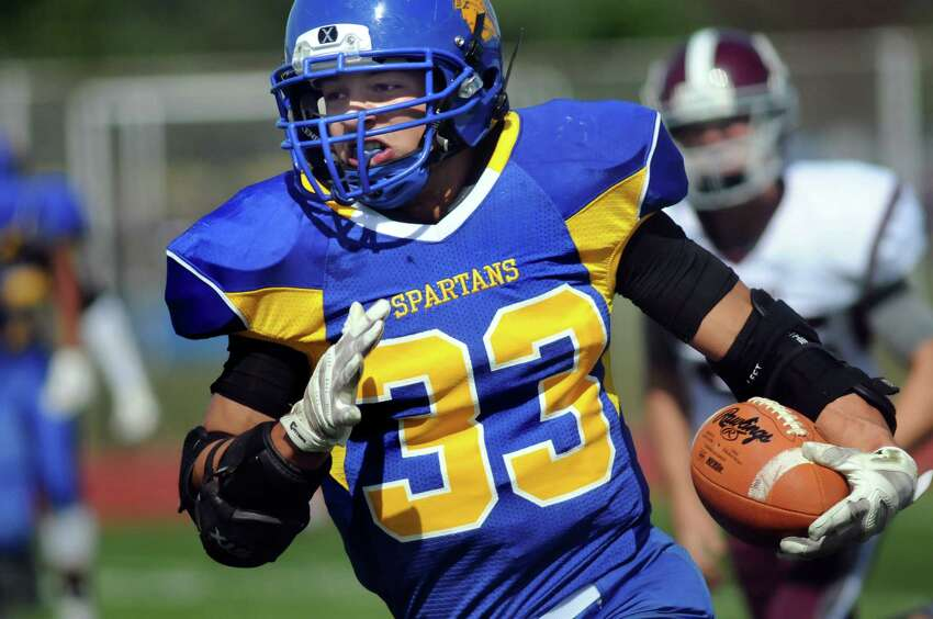 Queensbury's Brett Rodriguez carries the ball during their football game against Burnt Hills on Saturday, Sept. 26, 2015, at Queensbury High in Queensbury, N.Y. (Cindy Schultz / Times Union)