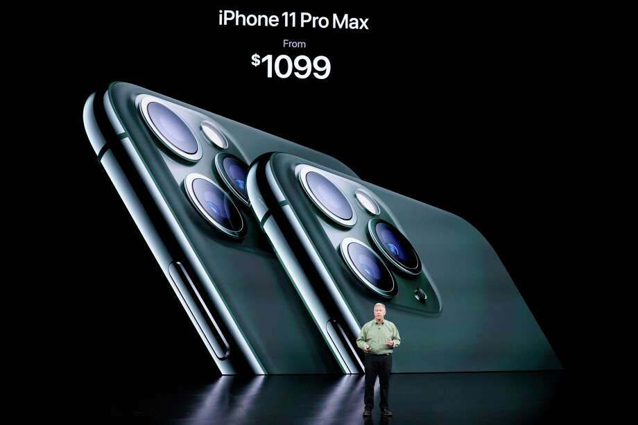 In this Sept. 10, 2019, photo, Phil Schiller, Senior Vice President of Worldwide Marketing, talks about the new iPhone 11 Pro and Max, during an event to announce new products in Cupertino, Calif. Apple's iOS 13 software update comes with plenty of privacy enhancements - though in some cases, you need to take the time to understand how they work. Among the changes: You'll be able to sign in to third-party services with your Apple ID account rather than Facebook's or Google's.  The free update is available for existing iPhones on Thursday, Sept. 19 and will ship with new models out Friday, Sept. 20.  (AP Photo/Tony Avelar) Photo: Tony Avelar, FRE / Associated Press / Copyright 2019 The Associated Press. All rights reserved