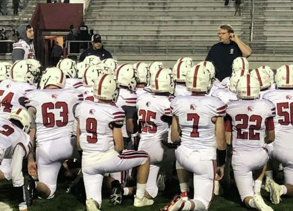 Foran High coach Tom Drew talks to his team after the Lions win over Bassick.