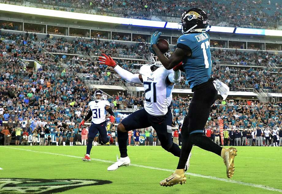JACKSONVILLE, FLORIDA - SEPTEMBER 19:  Wide receiver D.J. Chark #17 of the Jacksonville Jaguars scores a touchdown in the first quarter over Malcolm Butler #21 of the Tennessee Titans during the game at TIAA Bank Field on September 19, 2019 in Jacksonville, Florida. (Photo by Mike Ehrmann/Getty Images) Photo: Mike Ehrmann / 2019 Getty Images