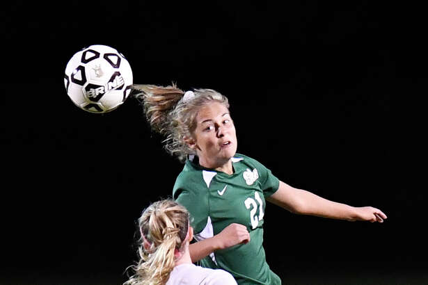 Shenendehowa's Ella White (21) heads the ball in front of Averill Park's Bryanna Swinson (3) during a Section II girls' high school soccer game in Clifton Park, N.Y., Thursday, Sept.19, 2019. (Hans Pennink / Special to the Times Union)