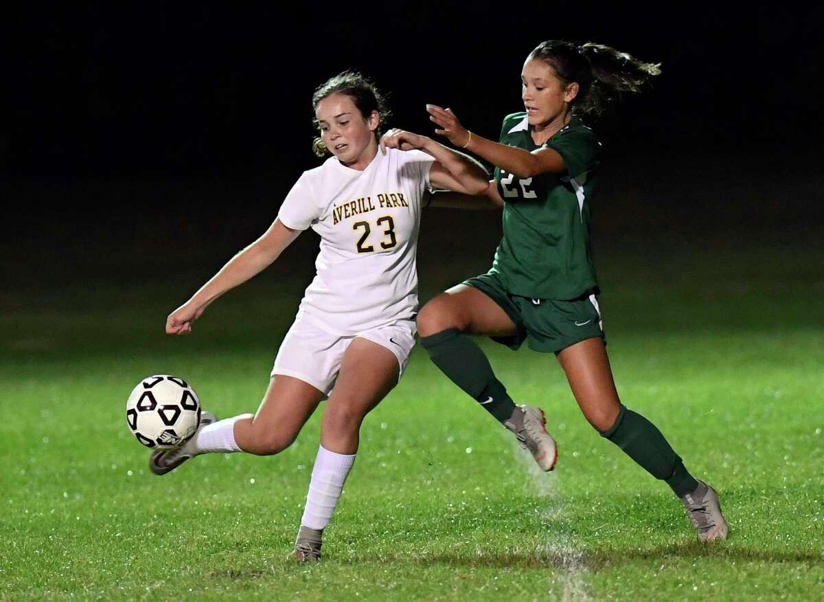 Averill Park's Catherine Gaylord (23) moves the ball against Shenendehowa's Georgia Greene (22) during a Section II girls' high school soccer game in Clifton Park, N.Y., Thursday, Sept.19, 2019. (Hans Pennink / Special to the Times Union)