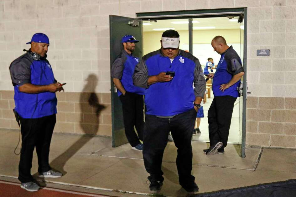 Jay coaching staff check reports after their game against O'Connor in their District 28-6A high school football game was delayed due to lighting early in the fourth quarter on Thursday on September 19, 2019 at Gustafson Stadium.