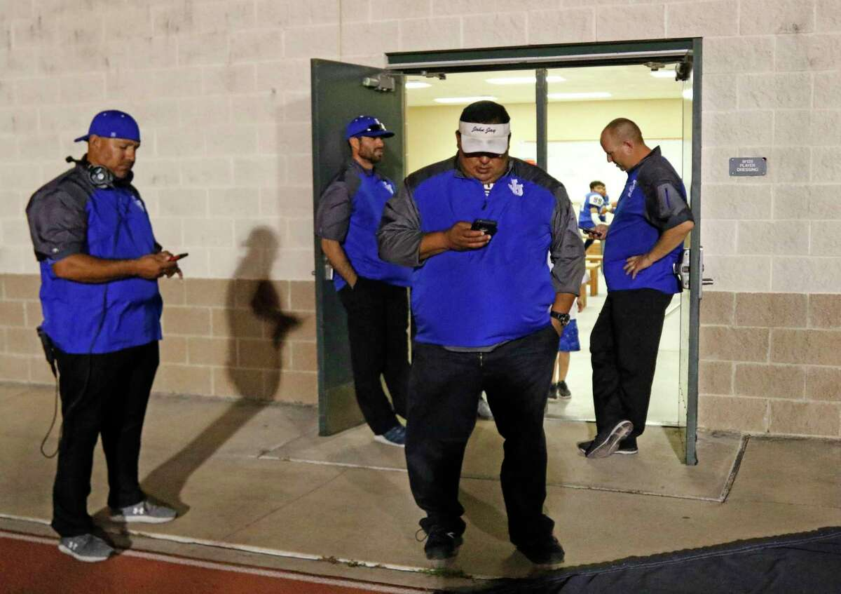 Jay coaching staff check reports after their game against O'Connor in their District 28-6A high school football game was delayed due to lightning early in the fourth quarter on Thursday on September 19, 2019 at Gustafson Stadium.