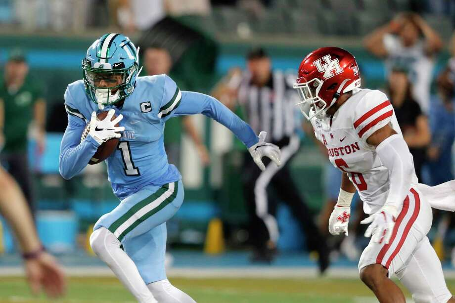 Tulane wide receiver Jalen McCleskey runs away from Houston cornerback Damarion Williams on the way to the winning touchdown during the final seconds Thursday. Photo: Gerald Herbert, Associated Press / Copyright 2019 The Associated Press. All rights reserved.