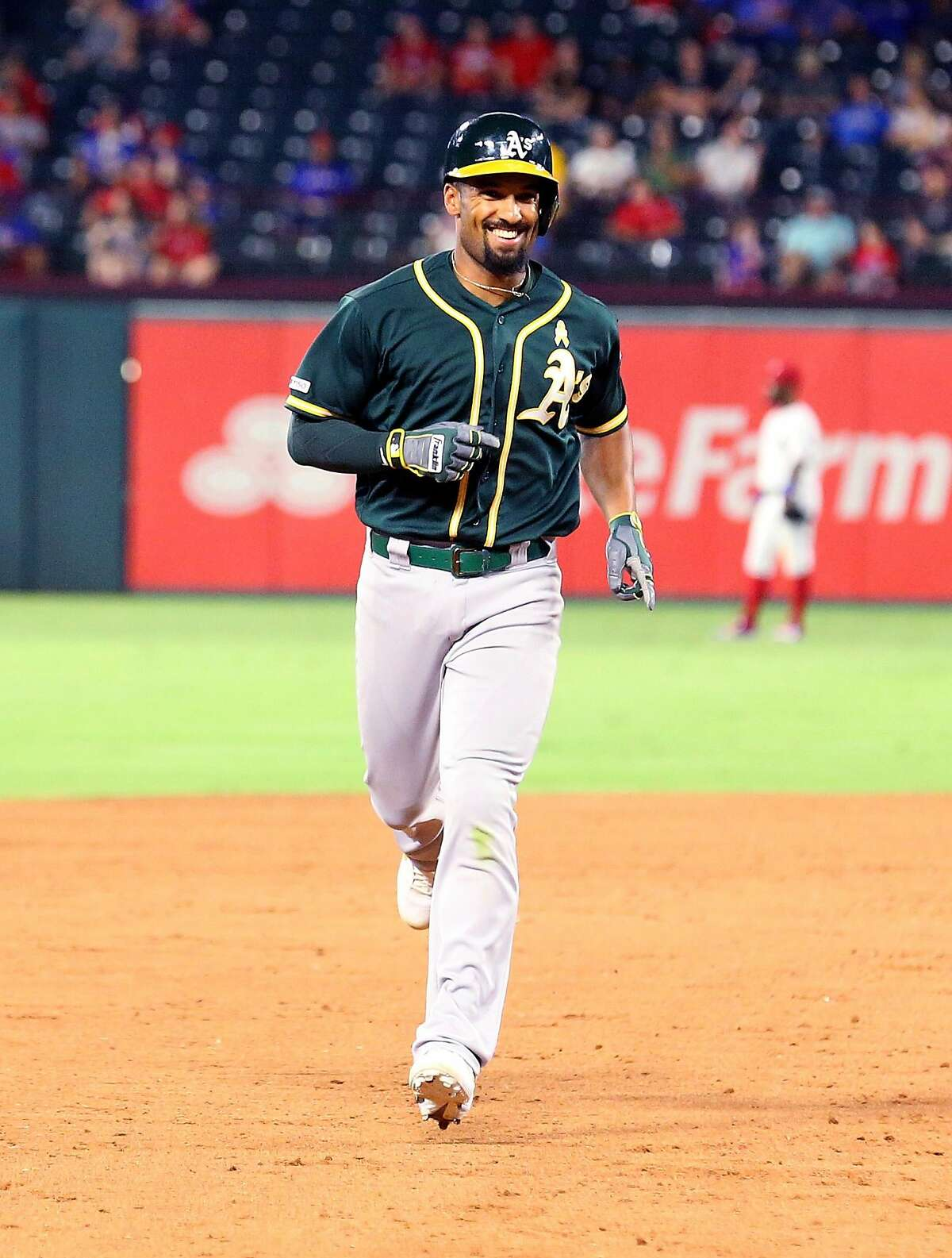 ARLINGTON, TEXAS - SEPTEMBER 13: Marcus Semien #10 of the Oakland Athletics runs the bases on a two-run home run against the Texas Rangers at Globe Life Park in Arlington on September 13, 2019 in Arlington, Texas. ~~