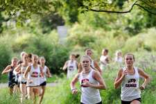 Competitors from Staples, Westhill, St. Joseph and New Canaan compete in an FCIAC cross country quad meet at Waveny Park in New Canaan, Connecticut on Sept. 10, 2019.