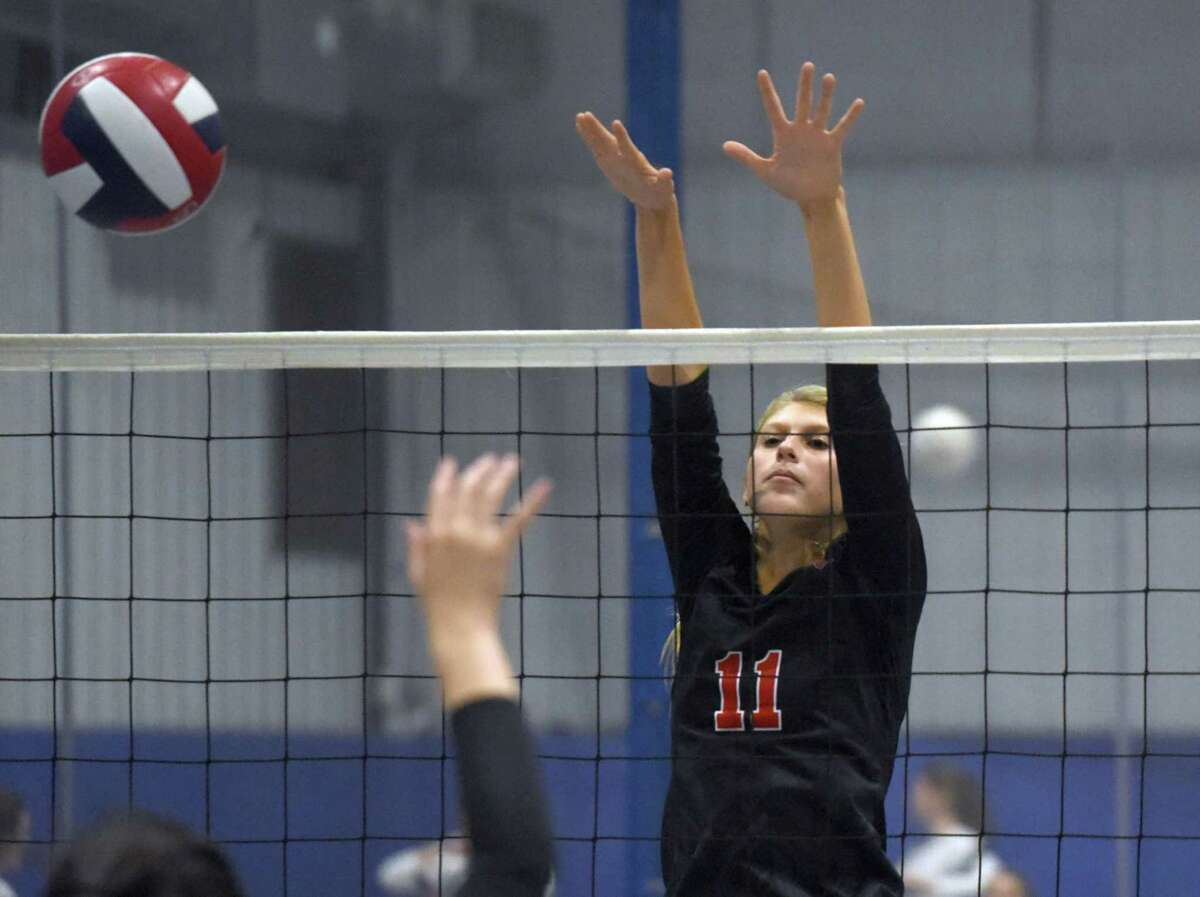 New Canaan's Ally Leopold goes up to attempt a block during the CIAC's Early Season Block Party Volleyball Tournament at the CT Sports Center in Woodbridge on Saturday, Sept. 14, 2019.