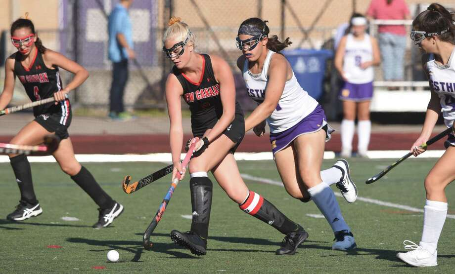 New Canaan's Emily Knight (8) brings the ball through the midfield with Westhill's Olivia Conte in pursuit during a field hockey game at Westhill High School in Stamford on Thursday, Sept. 19, 2019. Photo: Dave Stewart / Hearst Media Connecticut / Hearst Connecticut Media