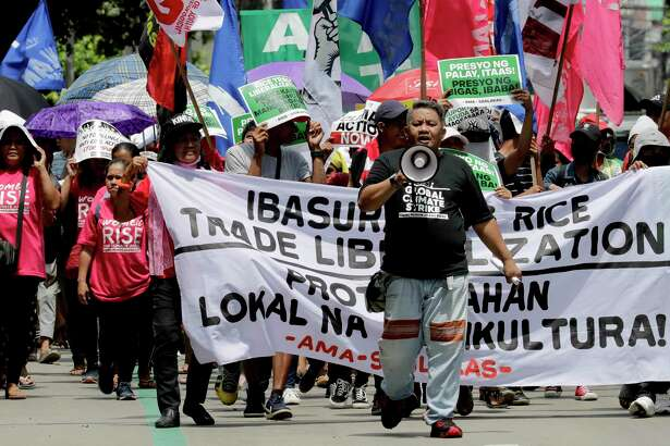 """Environmental activists march a short distance for a rally outside the Department of Environment and Natural Resources to coincide with the global protests on climate change Friday, Sept. 20, 2019 at suburban Quezon city, northeast of Manila, Philippines. Various environmental groups in the country are participating in what is expected to be the world's largest mobilization on climate change known as """"Global Climate Strikes."""""""