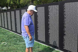 Pictures from a replica of the Vietnam Memorial Wall that visited Rushville City Cemetery on Thursday. The replica is a part of the 100th annual Smiles Day celebration for Schuyler County veterans.