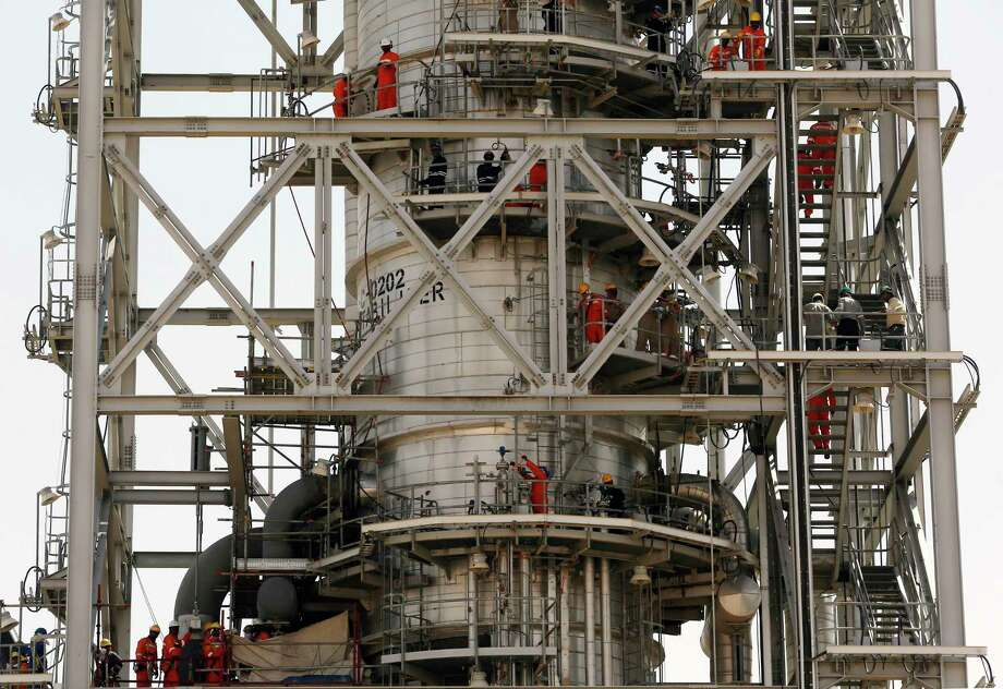 In this photo opportunity during a trip organized by Saudi information ministry, workers fix the damage in the Aramco's Khurais oil field, Saudi Arabia, Friday, Sept. 20, 2019, after it was hit during Sept. 14 attack. Saudi officials brought journalists Friday to see the damage done in an attack the U.S. alleges Iran carried out. Photo: Amr Nabil, AP / Copyright 2019 The Associated Press. All rights reserved