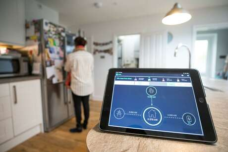 Big Oil companies are experimenting with smart systems to manage home energy as they prepare to survive in a low-carbon world.