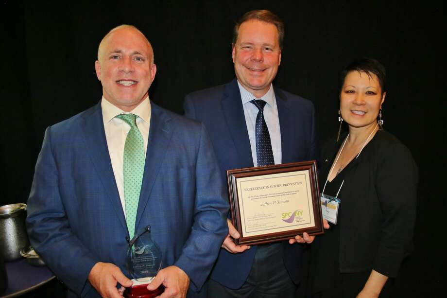 (L-R) James McHugh, Assistant Superintendent for Curriculum and Instruction; Jeff Simons, Superintendent of Schools; Tina Yun Lee, Community Education and Outreach Manager for NAMI-NYS Photo: NYS Office Of Mental Health
