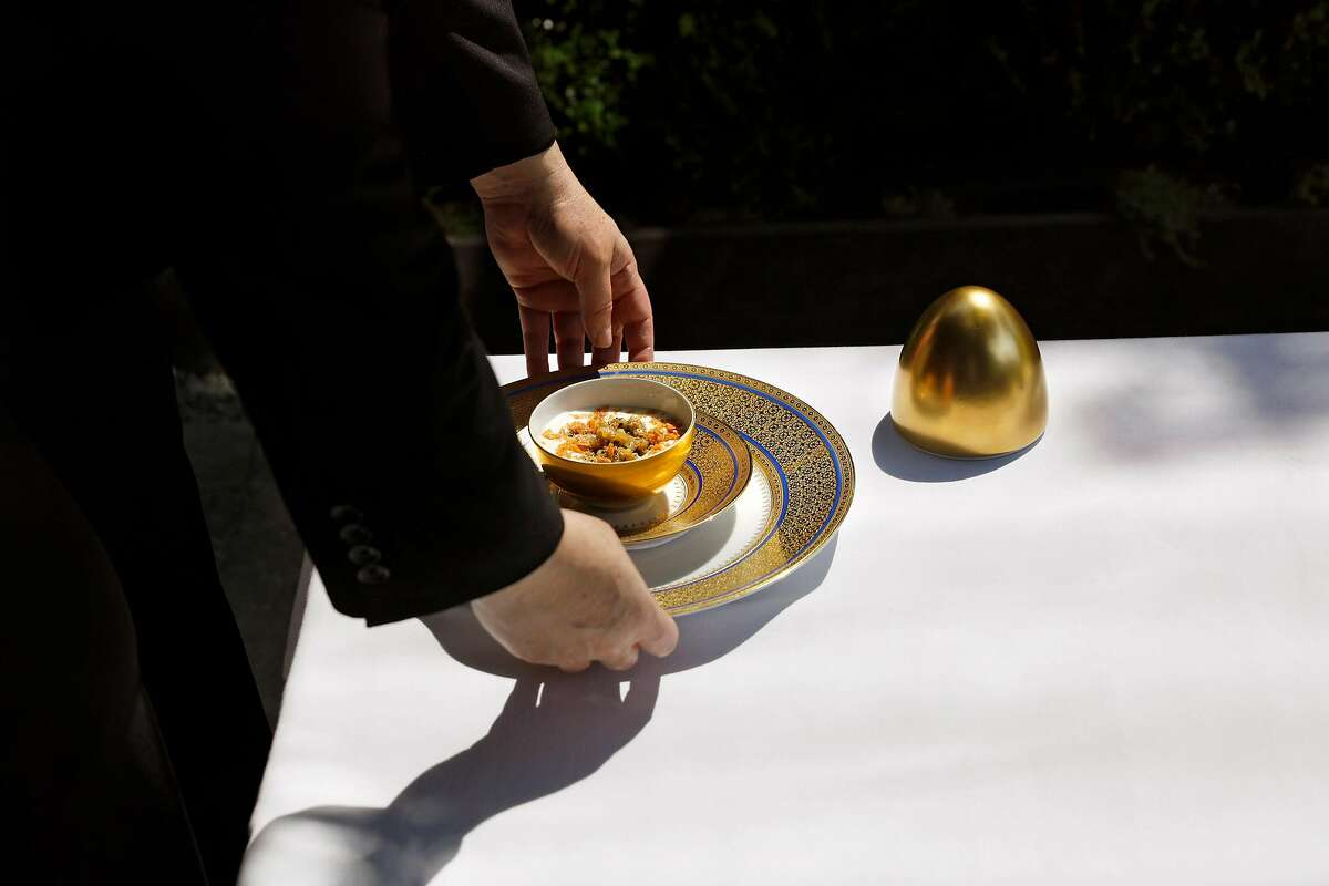 Macaroni and cheese with parmesan mousseline, served inside a golden egg at the French Laundry in Yountville, Calif., Sept. 8, 2019. Few parts of the country can rival Napa Valley for its concentration of this nostalgic genre of fine dining: grand destination restaurants with big reputations, extravagant food and deep wine cellars. (Preston Gannaway/The New York Times)