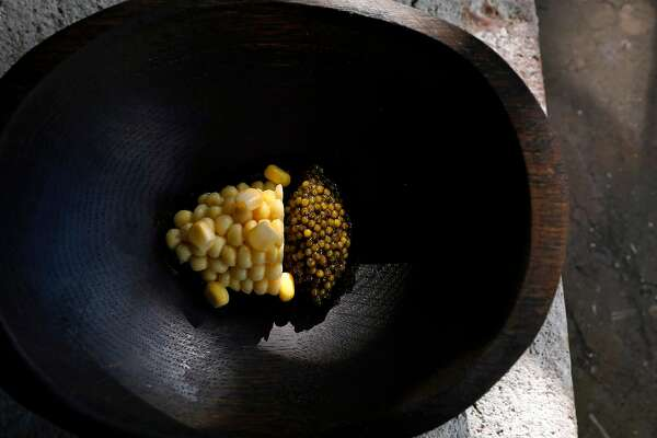 Corn custard, served with caviar and pecan oil at Meadowood in St. Helena, Calif., Sept. 5 2019. Few parts of the country can rival Napa Valley for its concentration of this nostalgic genre of fine dining: grand destination restaurants with big reputations, extravagant food and deep wine cellars. (Preston Gannaway/The New York Times)