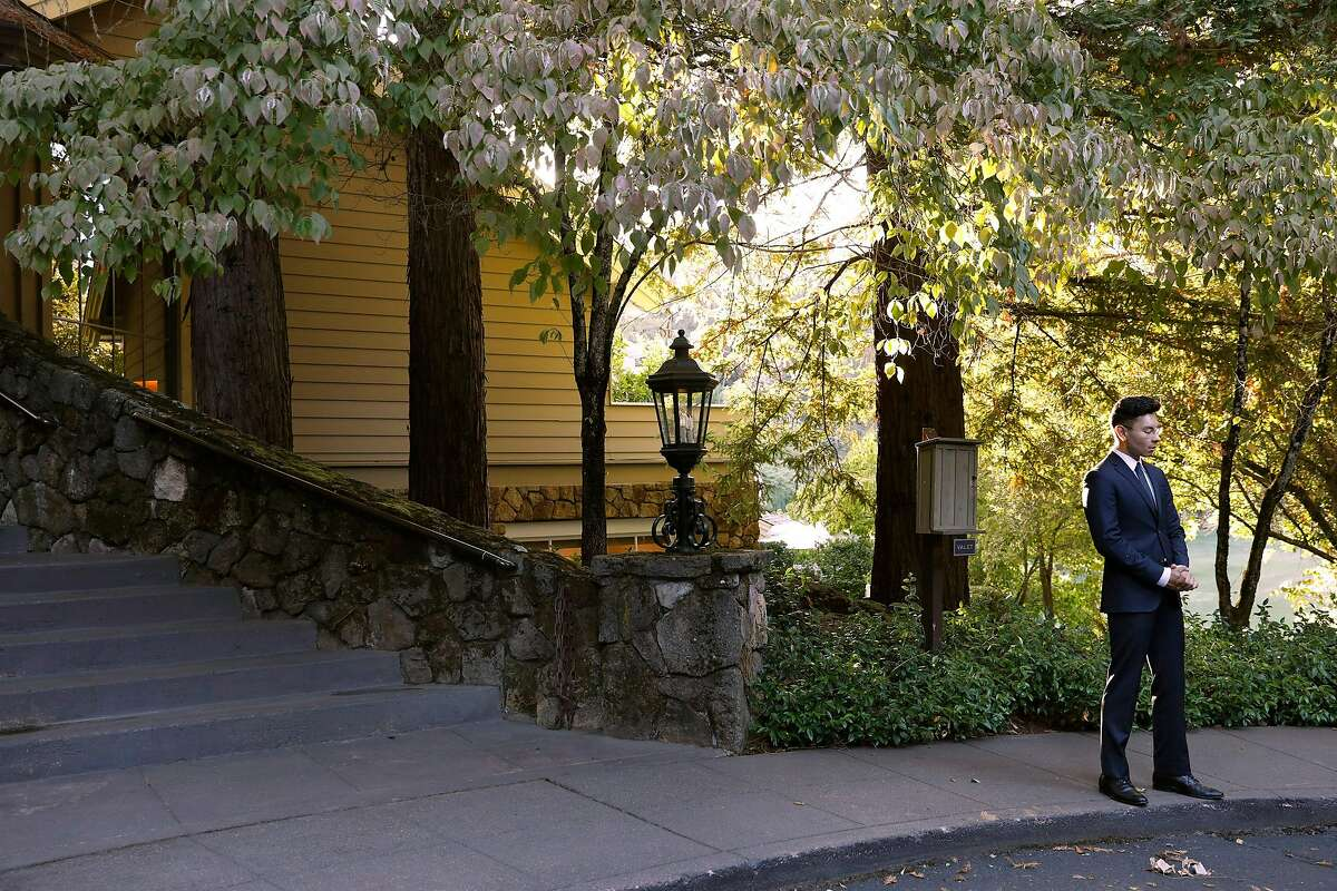 A valet awaits outside Meadowood in St. Helena, Calif., Sept. 5 2019. Few parts of the country can rival Napa Valley for its concentration of this nostalgic genre of fine dining: grand destination restaurants with big reputations, extravagant food and deep wine cellars. (Preston Gannaway/The New York Times)
