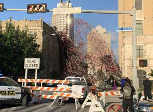 Three people were injured after wind and rain caused a piece of scaffolding to fall off the AT&T building Thursday night.