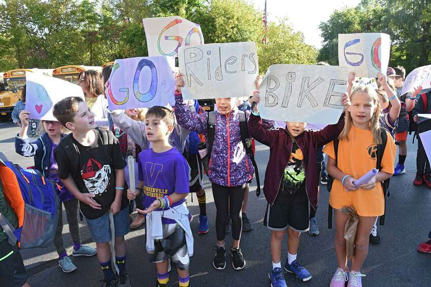 Voorheesville Elementary School students cheer for bike riders during a stop in the 12th annual Albany Ride for Missing Children on Friday, Sept. 20, 2019 in Guilderland, N.Y. The riders raise money for the National Center for Missing and Exploited Children, which goes towards continued investigation on active cases, and providing safety education programs. (Lori Van Buren/Times Union)