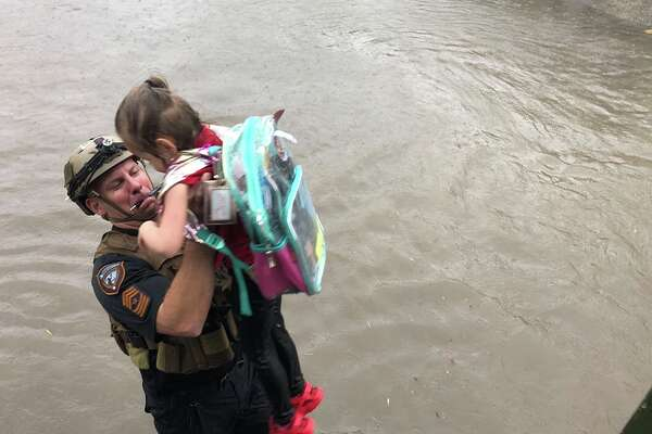 Harris County Sheriff's Office HCSO Sgt. Brawner gives a lift to an Aldine ISD student looking for higher ground.
