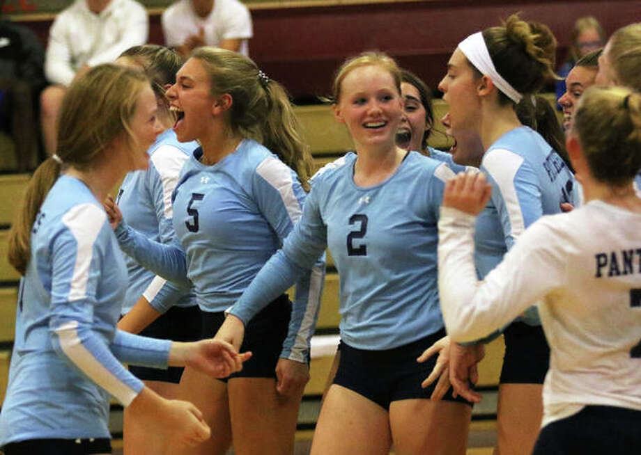 The Jersey Panthers celebrate their third-set victory over Marquette to win a tourney title last Saturday at Wood River. The Panthers had another happy result Thursday night in Jerseyville with a rare MVC victory over Mascoutah. Photo: Greg Shashack / The Telegraph