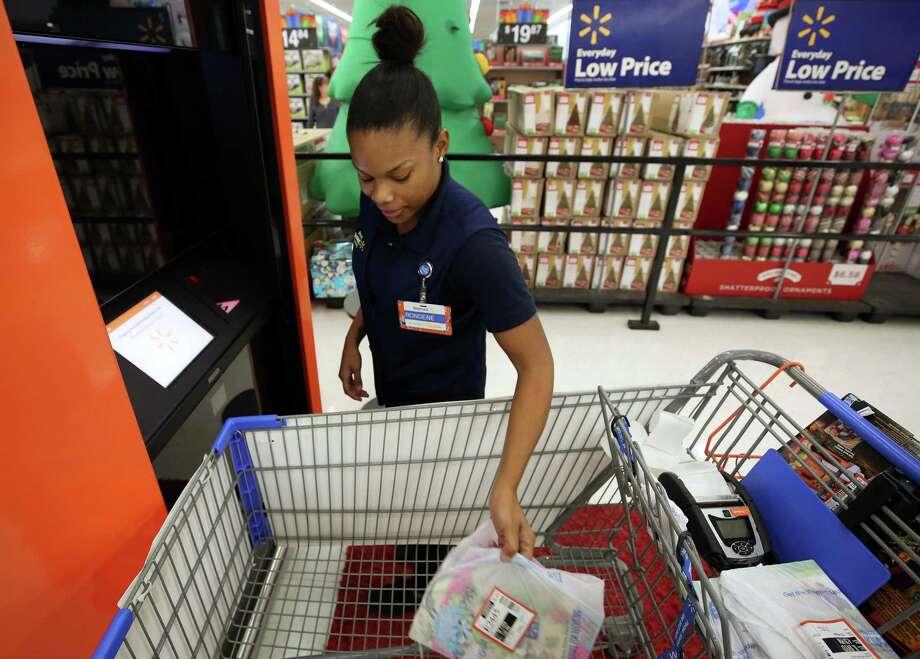 A Walmart employee fulfills an online order in Katy, Texas. Photo: Godofredo A. Vasquez,  Houston Chronicle / Houston Chronicle / Godofredo A. Vasquez