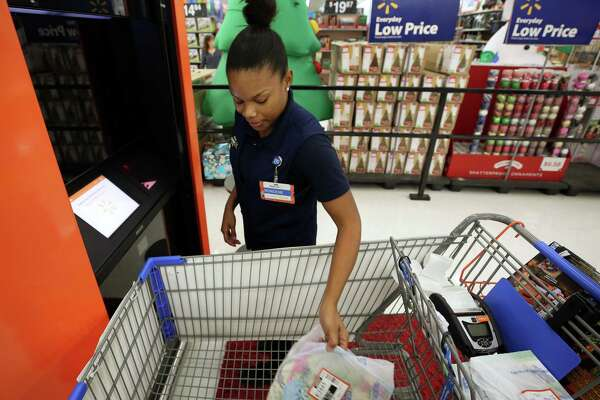 A Walmart employee fulfills an online order in Katy, Texas.