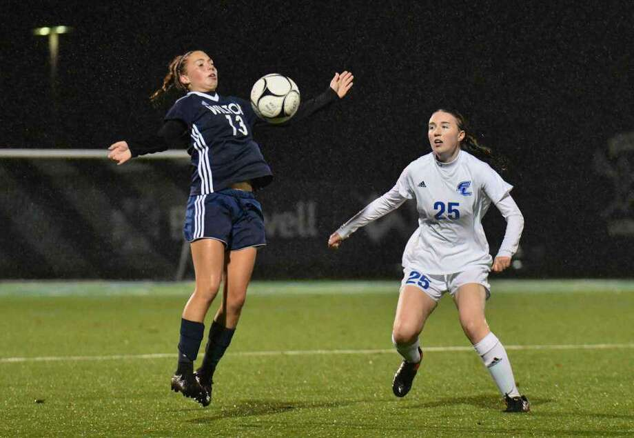 Ashley Carbonier (left, shown in a game last season) scored two goals as Wilton beat Westhill, 3-0, on Thursday. Photo: Gregory Vasil / For Hearst Connecticut Media