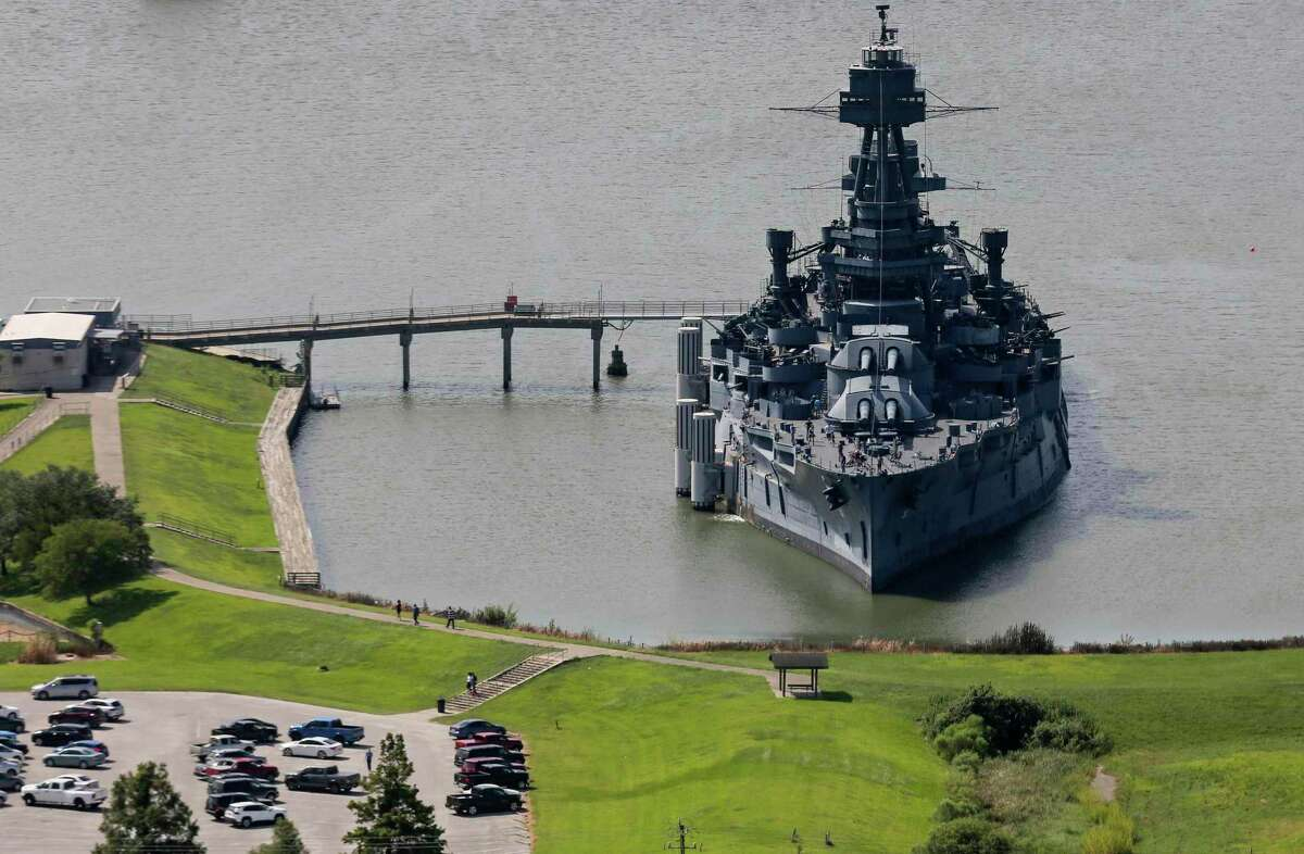 FILE - This Aug. 11, 2019, file photo, shows Battleship Texas, which served both World War I and World War II, in Houston. Interest in bringing the Battleship Texas to Galveston is mounting as a citizen-led committee prepares to release a report outlining recommendations on where to berth the historic ship. The Galveston County Daily News reports Seawolf Park on Pelican Island and Pier 21 on Galveston's harbor have emerged as favorites, though there's been no final decision about where the vessel might dock. (Godofredo A Vásquez/Houston Chronicle via AP, File)