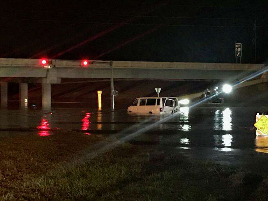 Harris County sheriff's deputies removed the body of Raul Eliseo Rivas-Hernandez from a van submerged in floodwaters at Will Clayton Parkway and Eastex Freeway on Thursday, Sept. 19, 2019. He was taken to the hospital, where he died.