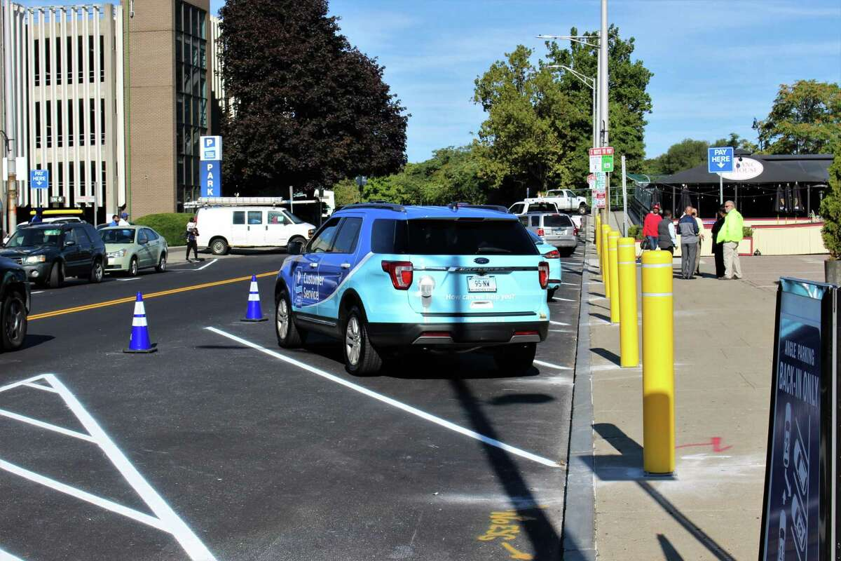 Norwalk officials unveiled new back-in angled parking in the Wall Street area on Friday, Sept. 20, 2019. Pictured here, are cars parked along River Street in the new spots.